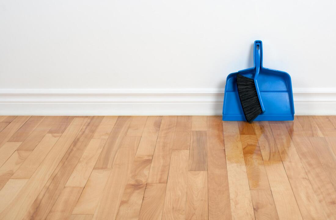 floor and the blue broom